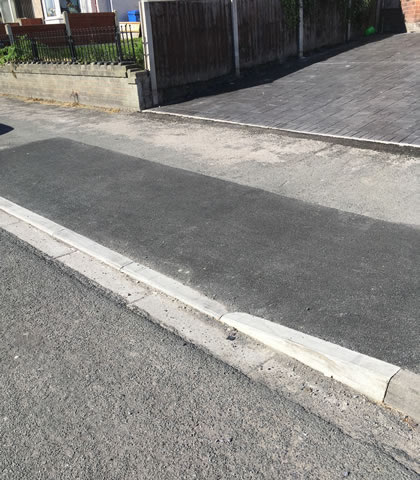 drop kerb stone installation